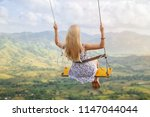 girl swinging on the redonda... | Shutterstock . vector #1147044044