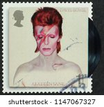 Small photo of Milan, Italy - July 27, 2018: Cover of LP Aladdin Sane on postage stamp