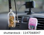 small buddha in cover in the car   Shutterstock . vector #1147068047