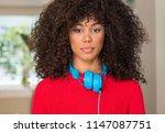 african american woman wearing... | Shutterstock . vector #1147087751