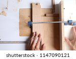 the carpenter works with wood... | Shutterstock . vector #1147090121