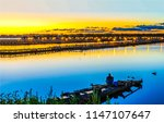 sunset river pier silhouette... | Shutterstock . vector #1147107647