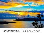 sunset sea island sky clouds... | Shutterstock . vector #1147107734