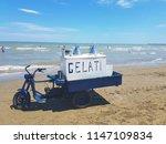 Selling ice cream on the beach, Barletta, Italy, Puglia