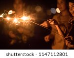 blurred of sparklers with group ... | Shutterstock . vector #1147112801