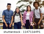 four teens relaxed looking at... | Shutterstock . vector #1147116491
