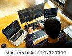 programmer work with developing ... | Shutterstock . vector #1147121144
