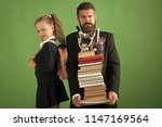 kid and tutor hold pile of... | Shutterstock . vector #1147169564