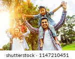 happy family having fun at the...   Shutterstock . vector #1147210451