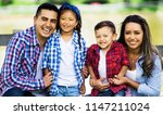 lovely latin family together | Shutterstock . vector #1147211024