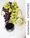 glass of white and red wine on... | Shutterstock . vector #1147242281
