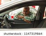 handsome african man examining... | Shutterstock . vector #1147319864