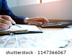 businessman analyzing... | Shutterstock . vector #1147366067