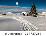 full moon above small hut and...