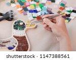 hands of master working on new... | Shutterstock . vector #1147388561