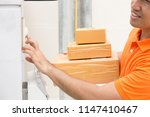 delivery man ring a bell to... | Shutterstock . vector #1147410467