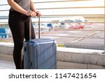 young woman with suitcase in... | Shutterstock . vector #1147421654