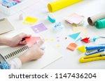 woman's hand cut paper making a ... | Shutterstock . vector #1147436204