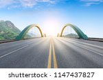 straight asphalt road and...   Shutterstock . vector #1147437827
