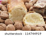 Dutch Christmas season treats, an almond roll surrounded by kruidnootjes and speculaas - stock photo