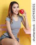 beautiful asian woman holding... | Shutterstock . vector #1147453031