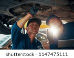 vietnamese mechanics checking... | Shutterstock . vector #1147475111
