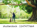 woman with a dog in the summer... | Shutterstock . vector #1147477664