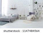 spacious stylish white loft... | Shutterstock . vector #1147484564