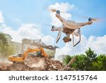drone inspecting construction... | Shutterstock . vector #1147515764