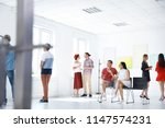 group of people at exhibition... | Shutterstock . vector #1147574231