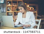 young business woman working on ... | Shutterstock . vector #1147583711
