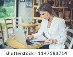 business young woman working in ... | Shutterstock . vector #1147583714