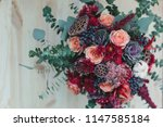 bouquet of autumn flowers in...   Shutterstock . vector #1147585184