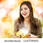 Happy Girl Opening a Gift Box - stock photo
