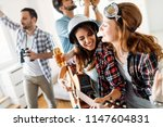 happy young friends having fun... | Shutterstock . vector #1147604831