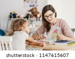 a professional child education... | Shutterstock . vector #1147615607