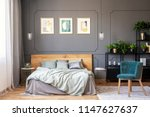 double bed with grey bedding... | Shutterstock . vector #1147627637
