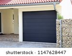 modern new garage door ... | Shutterstock . vector #1147628447