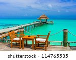 cafe on the beach  ocean and sky | Shutterstock . vector #114765535
