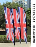 union jack flags blowing in the ... | Shutterstock . vector #1147658861