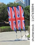 union jack flags blowing in the ... | Shutterstock . vector #1147658894