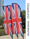 union jack flags blowing in the ... | Shutterstock . vector #1147659521