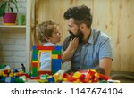 father and son looks at each... | Shutterstock . vector #1147674104