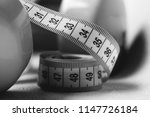 roll of cyan flexible ruler ... | Shutterstock . vector #1147726184