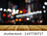 wood table bokeh light street... | Shutterstock . vector #1147730717