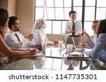 asian businessman addressing... | Shutterstock . vector #1147735301