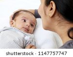 cheerful mother playing with... | Shutterstock . vector #1147757747