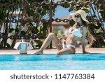 slim beautiful brunette in... | Shutterstock . vector #1147763384