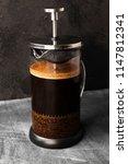 coffee in french press on dark...   Shutterstock . vector #1147812341