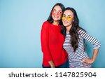 two beautiful brunette women in ... | Shutterstock . vector #1147825904